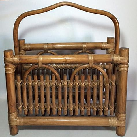 This vintage Mid-Century Modern magazine rack has a very thick rattan frame, with thinner pieces forming the walls of the...
