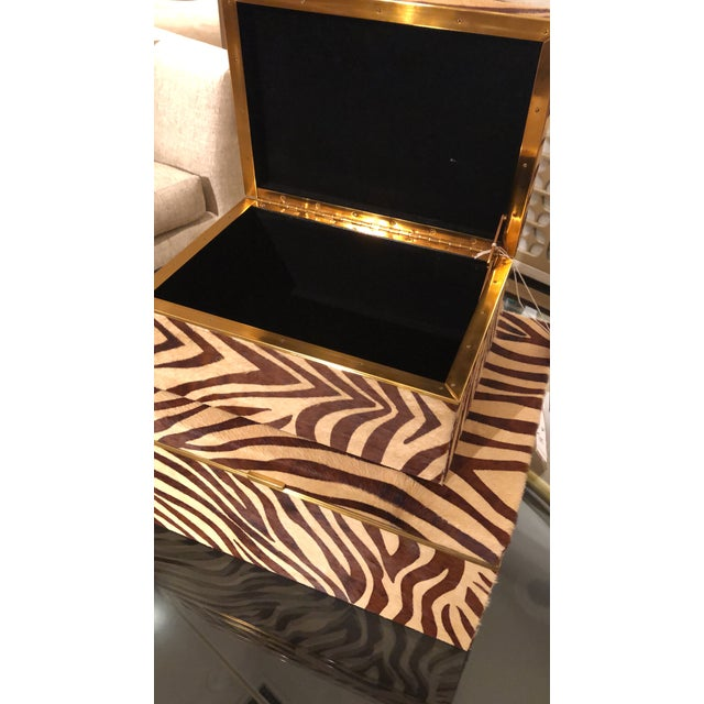 Set of two Faux Zebra Hair Hide Inlaid Boxes with Brass Accents. Lovely and stylish storage pieces!