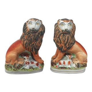 Pair of 19th Century English Staffordshire Lions with Lambs For Sale