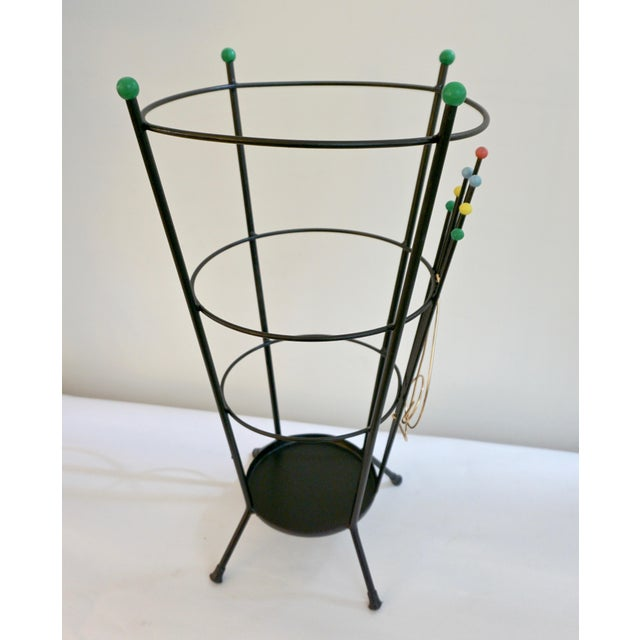 A delightful Italian umbrella stand by Stilnovo in black lacquered metal of conical flared shape, the minimalist modern...