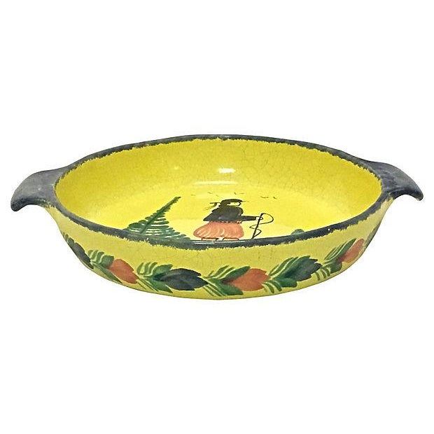Vintage, French, Quimper, hiker, serving bowl with handles. Depicts a hand-painted hiker figure at the center with floral...