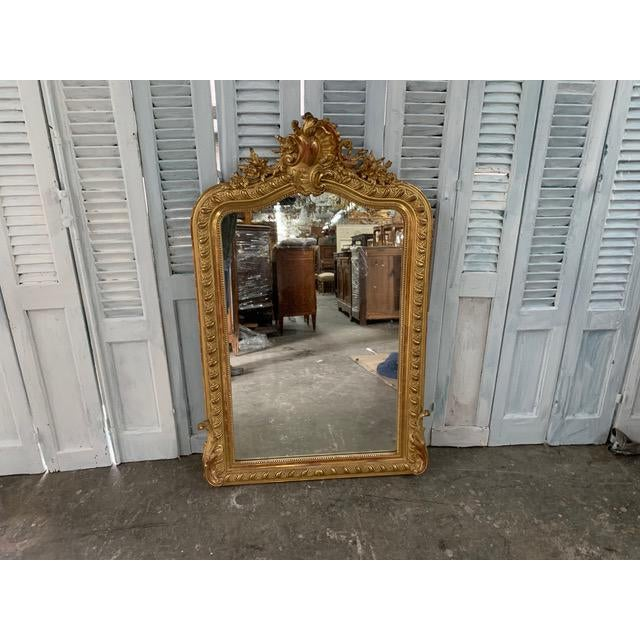 Beautiful 18th century Louis Philippe mirror with original glass. The outer frame is intricately gilded with floral and...
