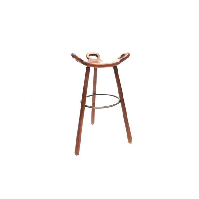 Set of four bar stools attributed to Carl Malmsten. These stools are made of solid beechwood, lacquered steel and...