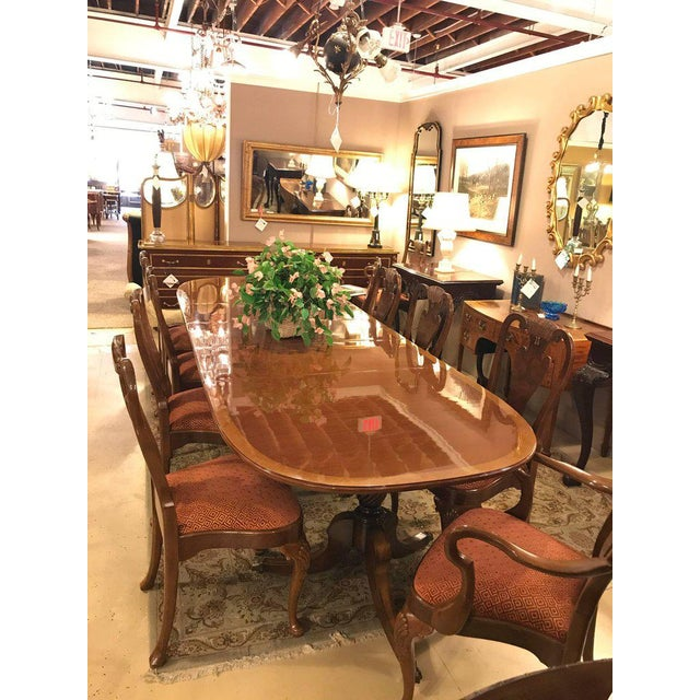Set of ten Queen Anne style dining room chairs. A pair of arm and eight side chairs comprise this fine custom quality set...