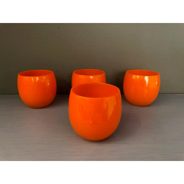 High end set of 4 mid-century hand blown orange cocktail glasses, great for your next retro party. Orange is THE color of...