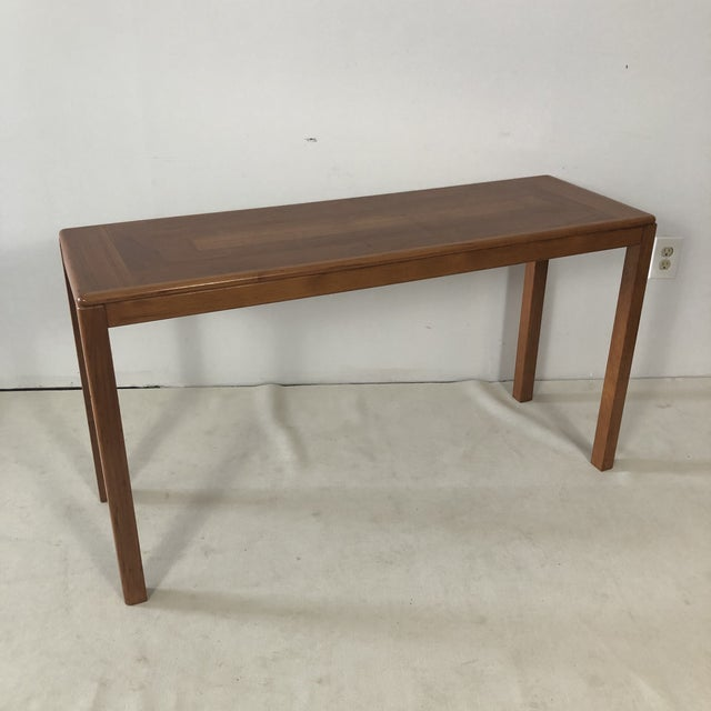 Teak console table made in Denmark by Lauritz Larsen Mobler. Wonderful in and entry, behind a sofa, in hallway or anywhere...