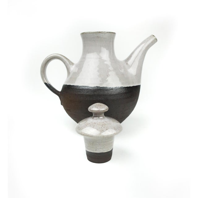 A perfect Danish Modern two tone ceramic tea pot by Henrik Ditlev Larsen. The upper portion of the pot & lid are glazed,...