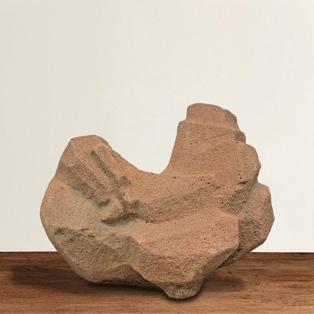 A fantastic modern abstract carved stone sculpture depicting a sleeping chicken with its head tucked over its back and its...