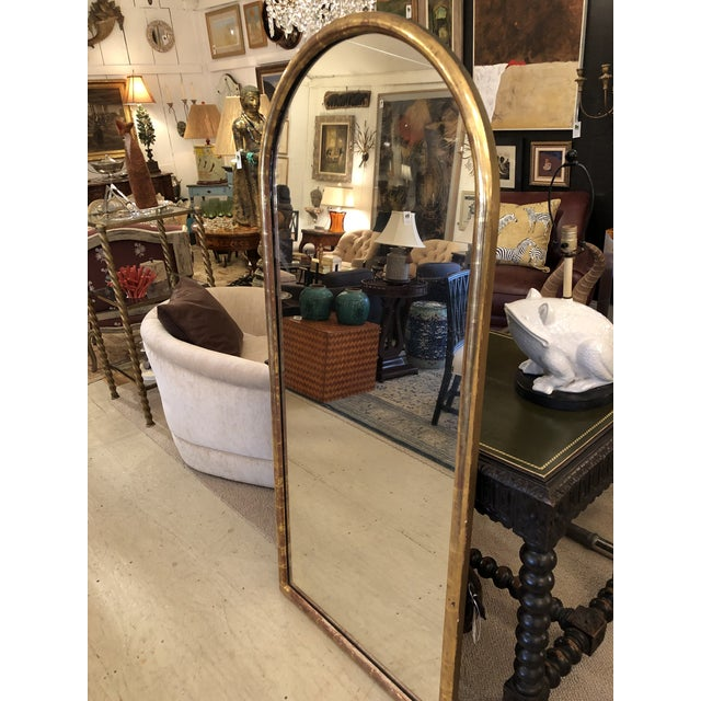 Beautiful and rare arch rounded very large lemon giltwood framed mirror retaining its original wood boards on its back....