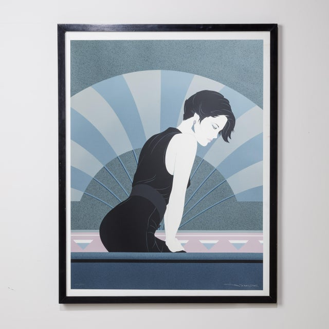 A Framed Art Deco Style Limited Edition Print of a Woman 273/350 by Patrick Nagel 1980s Price includes 10% VAT which is...
