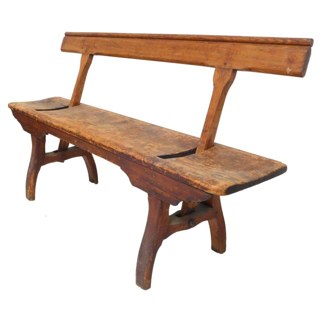 An outstanding, Primitive, turn-of-the-century wood bench. Incredible details and handmade craftsmanship with a...