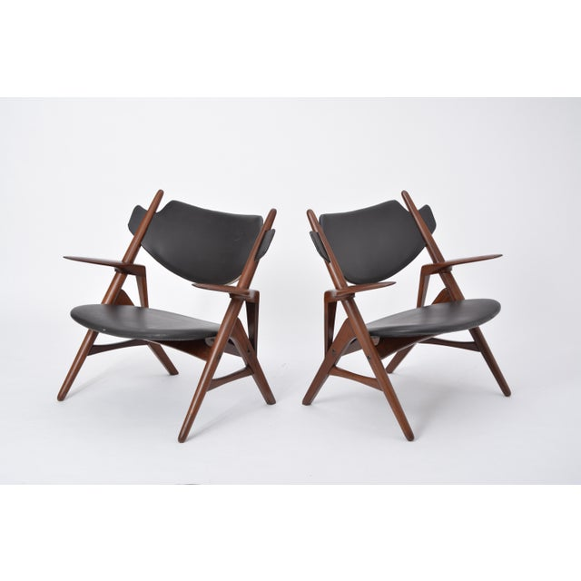 These chairs were produced in the 1950s. They look like a variation of Hans Wegner's famous Sawbuck chair. The structures...