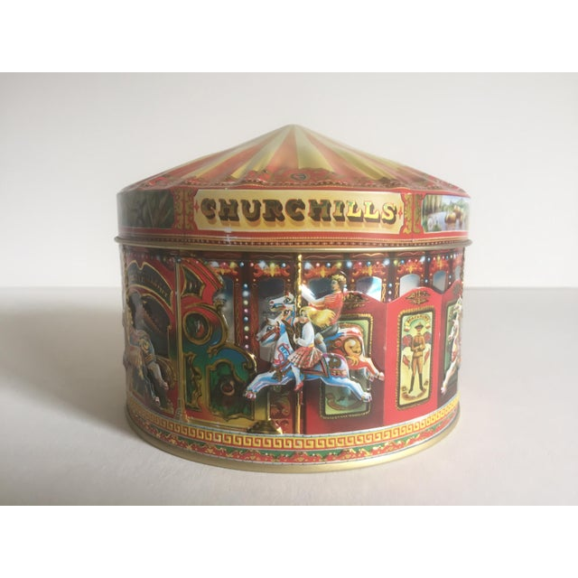 This authentic vintage Churchill's of London carousel candy tin container box with lid is a very special and unique piece...
