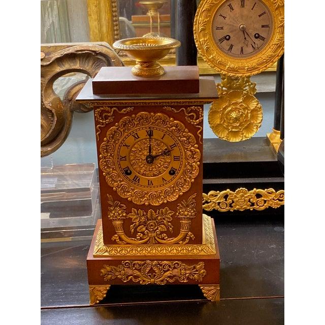 "French empire ormolu style clock with key. 9.5"" Wide x 5.5"" deep x 18.25"" High"