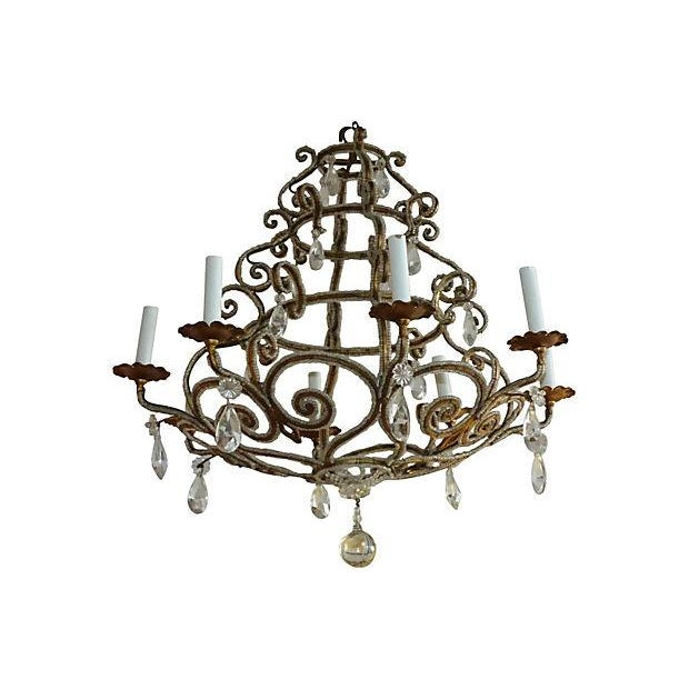Chandelier with intricate glass beading throughout and glass teardrop crystals. US wired and in working condition; takes...