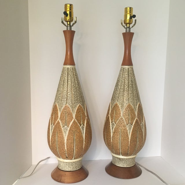 Original signed 50s mid-century modern F.A.I.P. table lamps. Classic design.