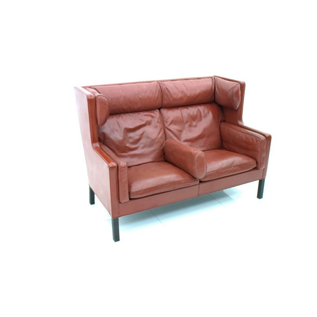 High back coupe leather sofa in red leather by Børge Mogensen for Frederica, 2192, Denmark. Very good condition. A second...