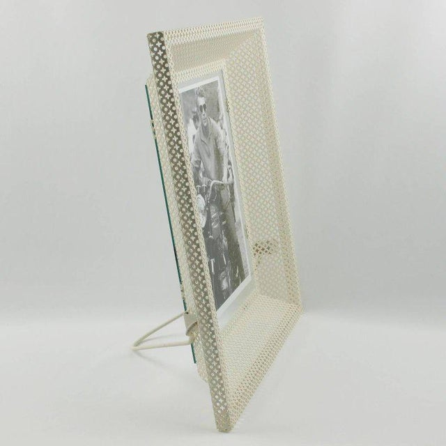 Rare Mid-Century Modern white picture photo frame by French designer Mathieu Mategot. A striking example of French 1950s...