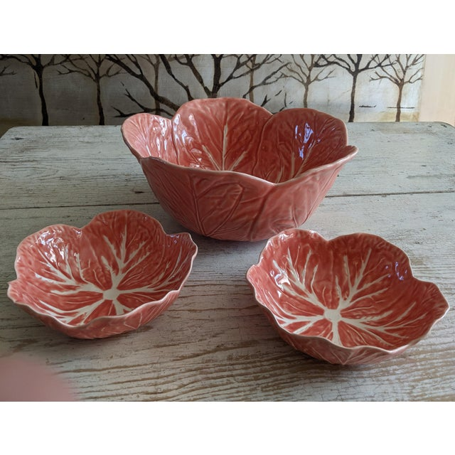 Vintage set of Pink/Salmon colored glazed cabbage leaf majolica pottery by Bordallo Pinheiro, Portugal. Featuring a large...