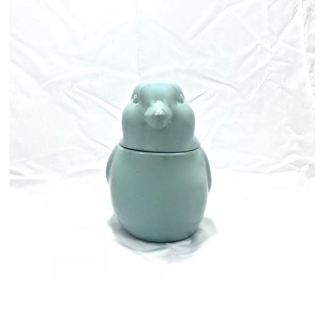 Ceramic bird cookie jar in a very pretty robin's egg blue color.