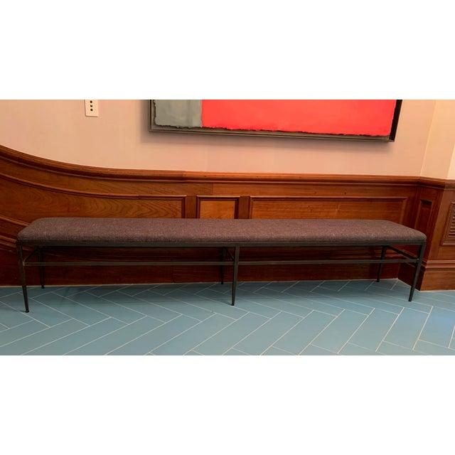 Custom oversized hall bench with black iron hardware and beautiful gray wool upholstery.