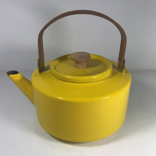 MCM teapot by Copco of Spain. Yellow enamelware with wooden handles. Michael Lax design. A couple of chips to the enamel,...