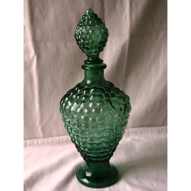 Gorgeous dark green glass decanter with a bubble glass design. Plastic lined stopper. Surface chip to rim of stopper-...