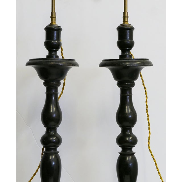 These Antique lamps are made from a pair of wooden candlesticks in France. Bring a French flair to your living room....