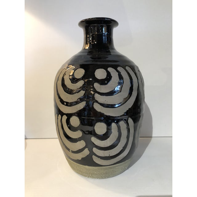A set of three eye catching, sturdy hand-made ceramic vases with bold and varying geometric designs. A trio. Heights range...