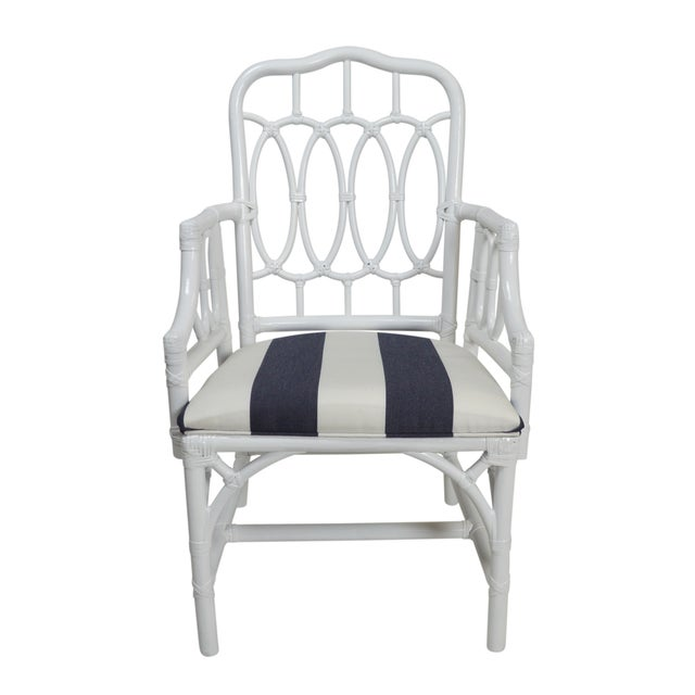 Set of four vintage rattan armchairs that have been newly lacquered in white. The seats are newly upholstered in a navy...