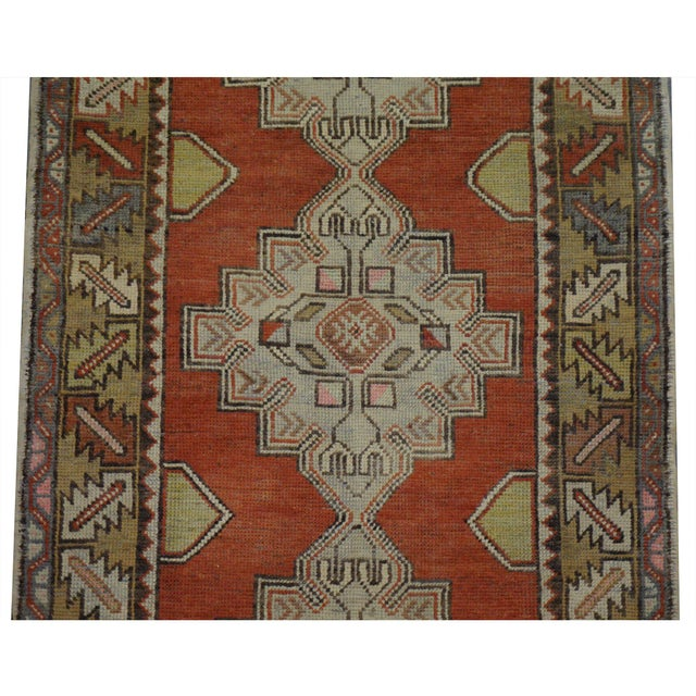 This beautiful vintage Turkish Oushak runner is hand-knotted, 100% wool, made in Turkey, Ushak region. It features a...