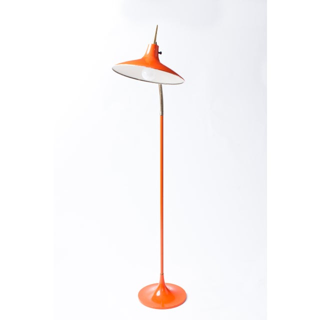 A graceful and sleek Mid-Century Modern floor lamp for Laurel, in the style of Gio Ponti, with an articulated brass...