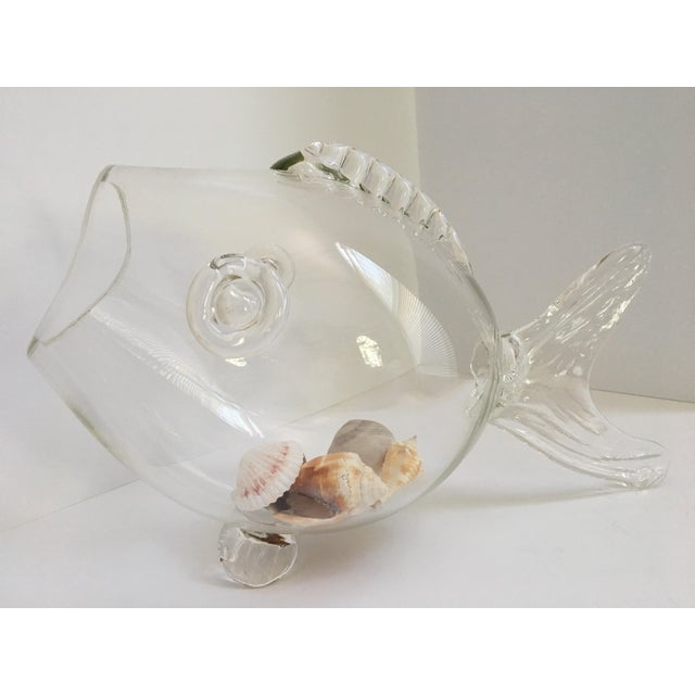This mid century hand blown clear glass fish can be used for many things! This is a perfect display bowl for sea glass and...