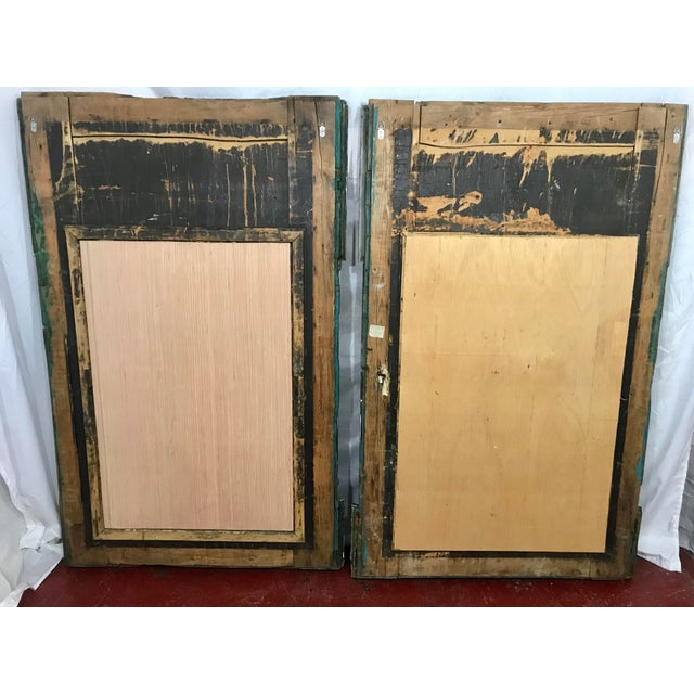 Highly unusual pair of Italian Neoclassical mirrors, these started life as part of a paneled interior. the faux paint on...