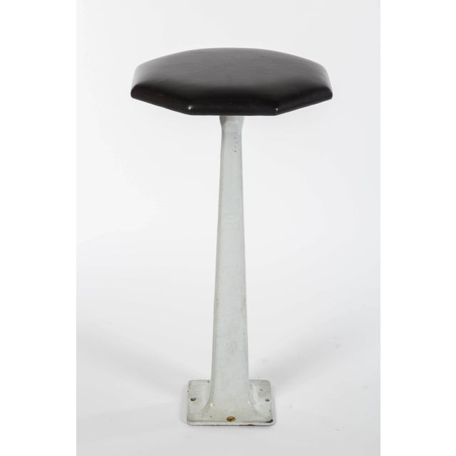 A pair of Industrial stools with painted iron bases and new black leather tops. Mounts into floor, USA, 1940s. Diameter...