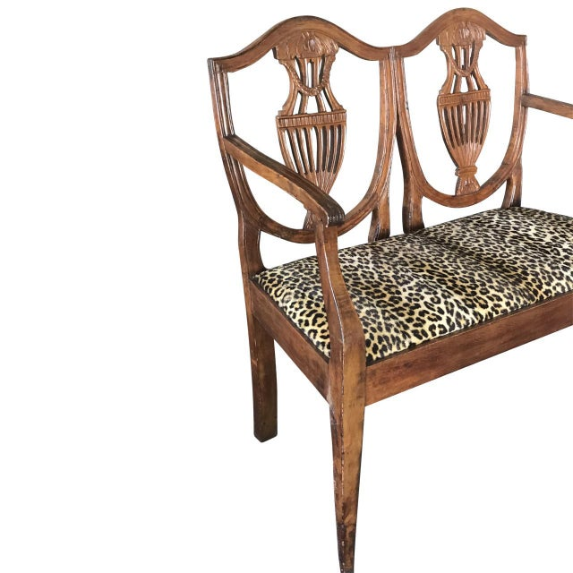 This is an antique Italian walnut settee. The piece dates back to the late 19th century.