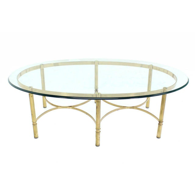 Nice mid-century oval brass and glass coffee table.