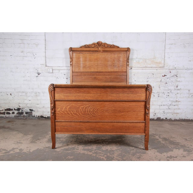 "A gorgeous antique carved tiger oak full size bed frame USA, Circa 1900 Measures: 58.5""W x 80.5""D. Headboard 75.63""H;..."