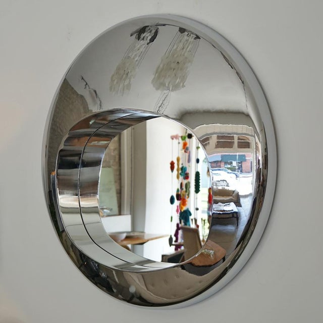 Reflections abound, this chrome orb mirror In the manner of Ron Arad will anchor any room.