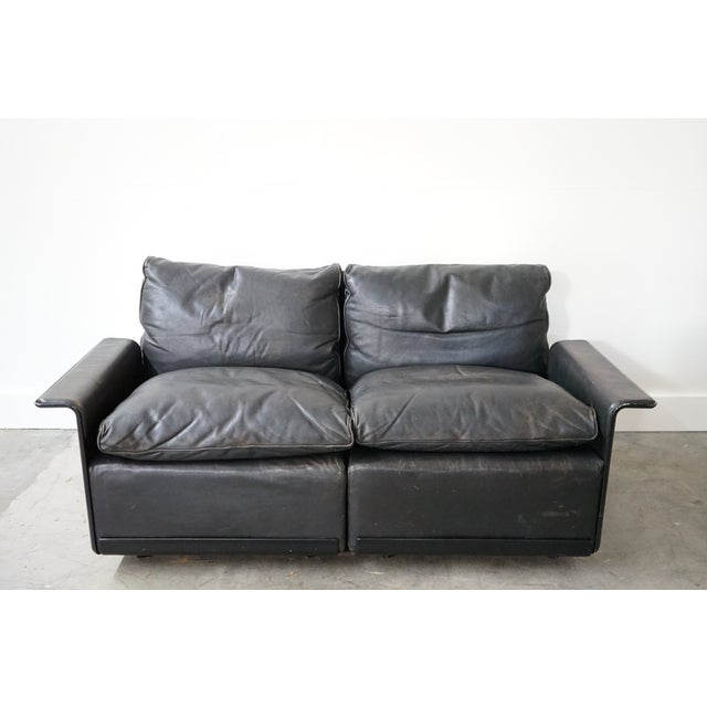 This is a settee designed by famous mid-century furniture designer Dieter Rams. It is a comfortable and petite settee with...