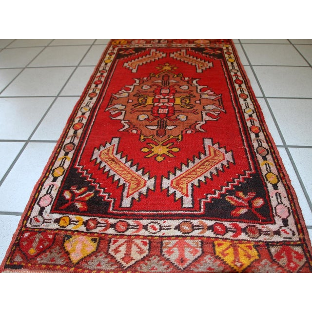 Handmade vintage Turkish Yastik rug in bright red colour. The rug is in original good condition from the middle of 20th...