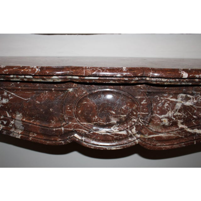 A French Louis XV style marble mantel.