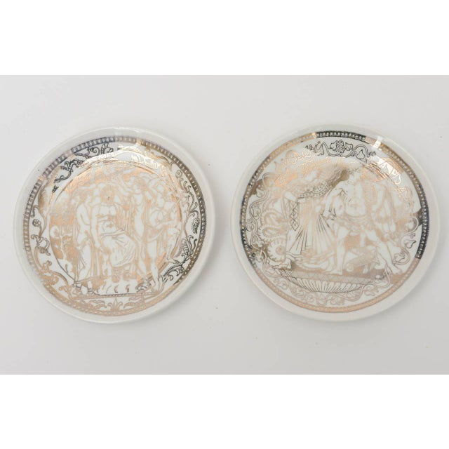 These hallmarked classical Italian Fornasetti coasters were made for the very chic store that once was called Bonwit...