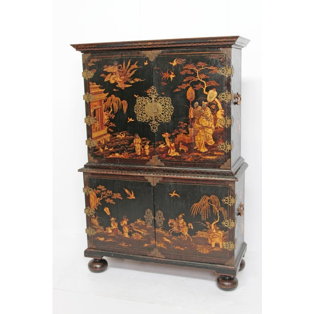 an English Queen Anne period collectors cabinet, black lacquer with raised gold decoration / Japanned (with Chinoiserie...