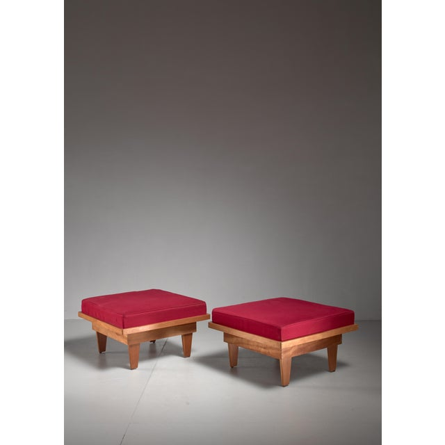 A pair of studio crafted ottomans. This mid-century American set is made of plywood and cushions with a red fabric...