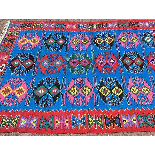 This beautiful vintage handwoven kilim is in fabulous shape. It is approximately 40 years old, handmade of very fine...