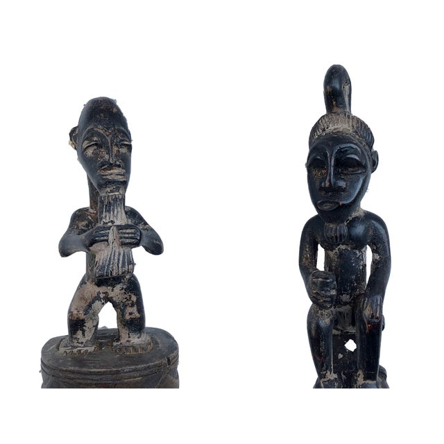 Superb hand-carved Baule tribe ceremonial broom with natural fiber bristles and a standing female figure holding her...