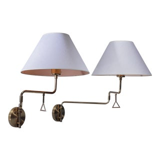 Pair of Swedish brass swiveling wall lamps