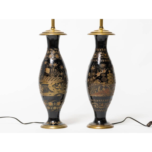 Pair of brass etched Asian motif table lamps.