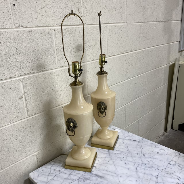 Classic Paul Hanson hen lamps in marble with brass lions heads on each side and brass base. Very heavy. Marble is an...